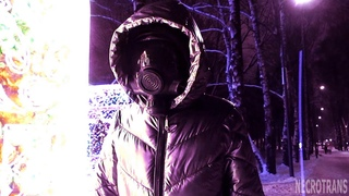 Transhumanist walks into the blaze of a new era. Steel-colored winter ski overalls and a gas mask.