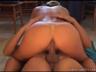 Milf in a green dress gets his dick hard and wet with her mouth so that she could ride him
