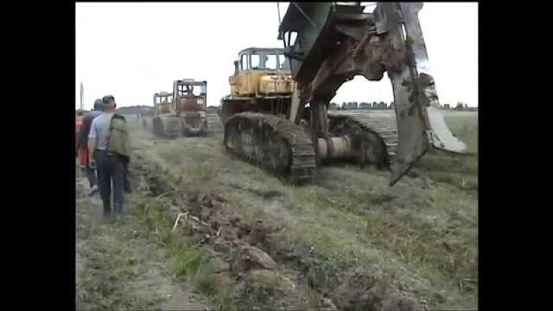 К700 Кировец Трактор на гусинецах с огромным ножом для прокладки кабелей связи