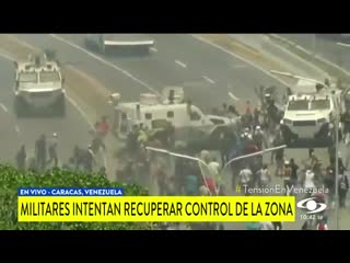 Breaking a military vehicle runs over pro-guaido protesters in caracas, venezuela.