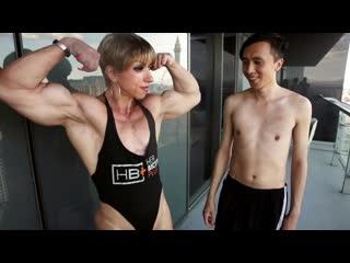 Vsm_huge_female_bodybuilder_dominates_