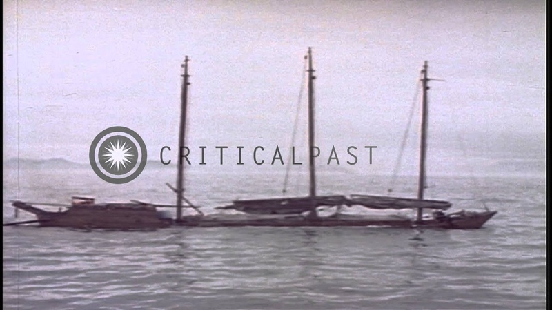 A Japanese sailing junk being attacked by a US submarine underway in the Pacific Stock Footage