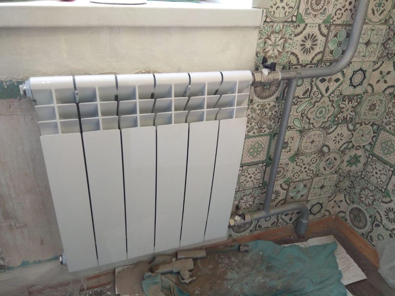 Проспект Строителей дом 46 установка радиатора в