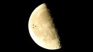 Large Disc Shaped UFO Seen Flying In Front Of The Moon